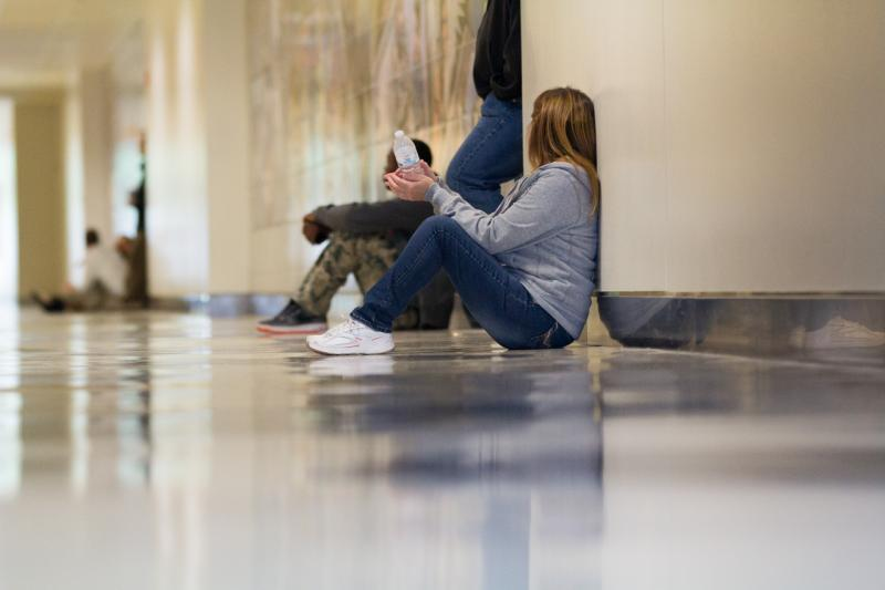 Families and youth wait in the hallway outside juvenile courtrooms, San Leandro, Calif.