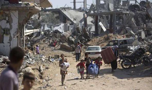 Families recover belongings from the rubble after returning to their homes in Gaza