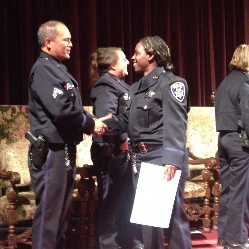 Officer Courtney Lewis receives her certificate.