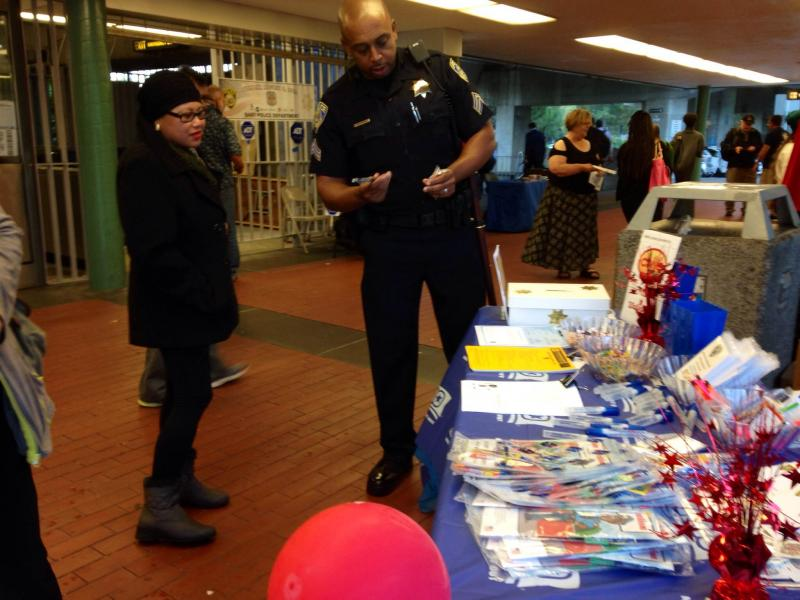 BART officers set up a table with free gifts for the public.