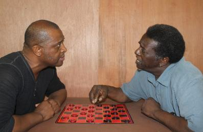 Fabian Herd and Vernon Medearis play two drivers, opponents in checkers and other matters as well.