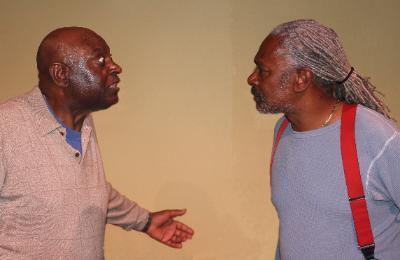 The head of a gypsy cab company (Bennie Lewis) argues with one of his drivers (Charles Johnson) about who's to blame.
