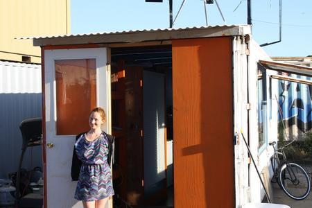 Heather Stewart of Boxouse stands in front of her shipping container home