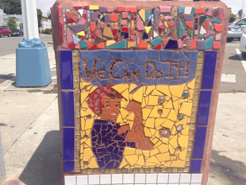 Rosie the Riveter smiles out from the side of a trashcan decorated by Daud Abdullah in front of Richmond's City Hall.
