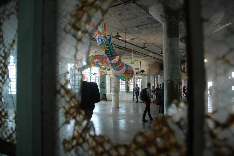Ai Weiwei's site-specific installations use the crumbling prison as part of the art.