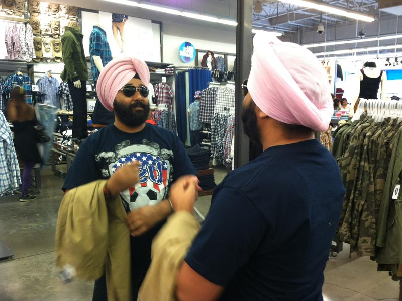 Dheeraj Singh trying on sunglasses at Old Navy in Emeryville