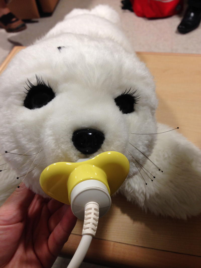 Paro the seal, charging by its electronic pacifier