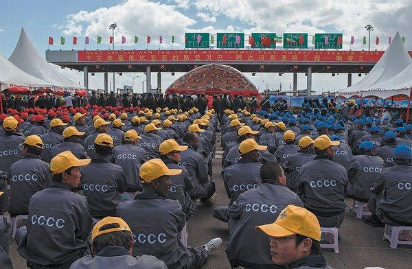 Ethiopian and Chinese workers from the China Communication Construction Company attending Chinese Premier Li Keqiang's visit to the site of the Addis Ababa–Adama toll road, May 2, 2014