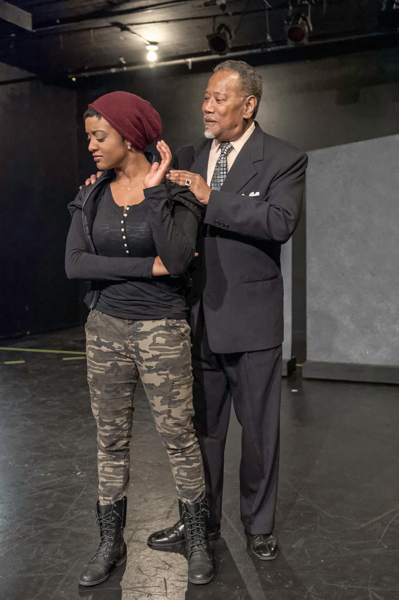 Marcellus (Robert Fisher) tries to reason with Tigs (Ryan Nicole Austin) in African-American Shakespeare Company's World Premiere of Nambi E. Kelley's Xtigone.