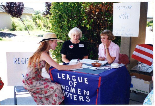 Aldene Crosswell and Vivian Thorsen of the Tri-Valley League of Women's Voters register a voter at Las Positas College in Livermore in 1995.