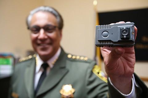 Sheriff Mirkarimi holds up a body camera