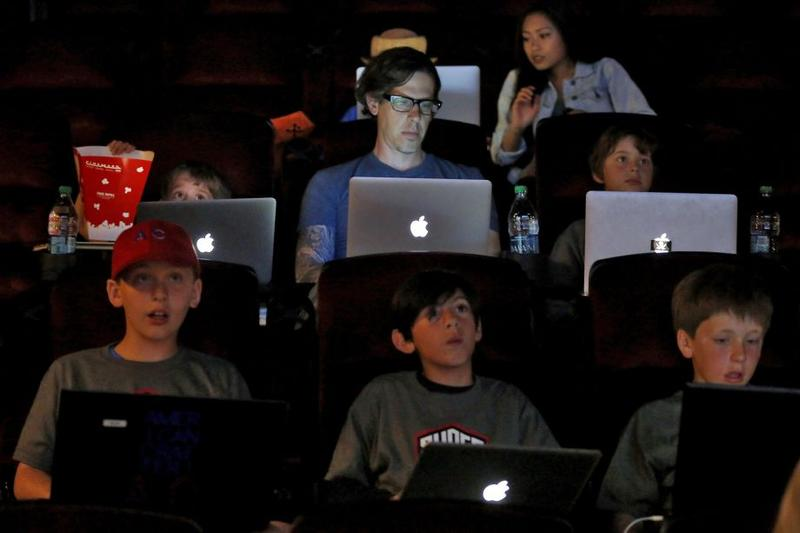 Chris Henley, 40, was one of more than 50 children and parents who took part in a game of Minecraft in a movie theater in Redwood City, California, on Tuesday, June 23, 2015.