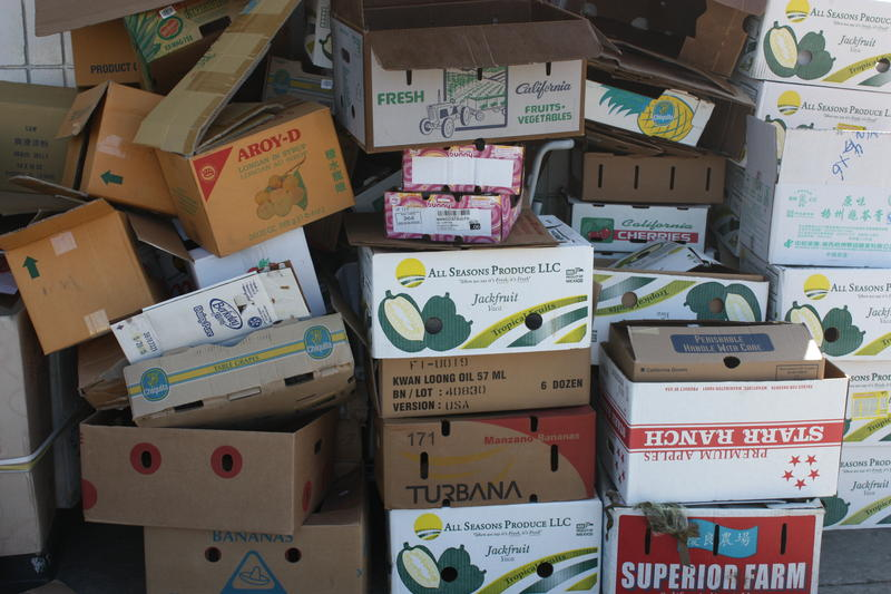 Empty produce boxes outside of Oakland's Sun Hop Fat Market