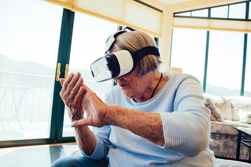 Pat Healy explored the world through a virtual reality headset on Saturday. The device is paired with a program developed by Marshall resident Frank Werblin to help people with macular degeneration.