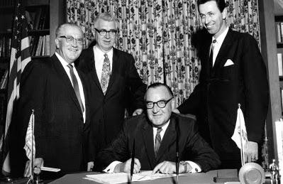 Governor Pat Brown signing the Donahoe Act implementing much of the Master Plan in 1960