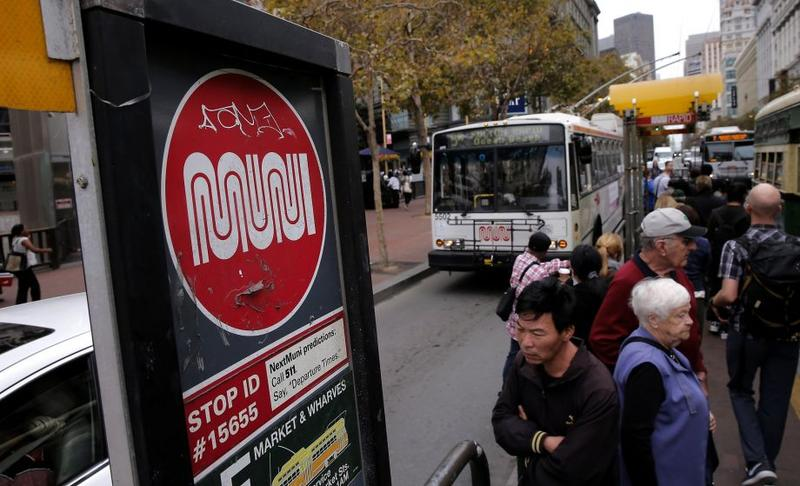 Riders board a MUNI bus along Market Street in San Francisco. A new survey of city residents by the San Francisco Controller's office asked them to grade local government and a host of departments. The library system scores the best and MUNI the worst.