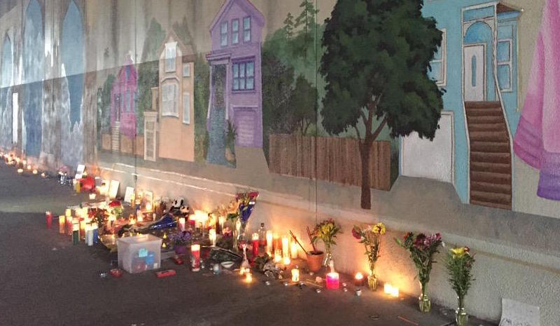 Candles for Antonio Ramos, artist killed working on West Street mural
