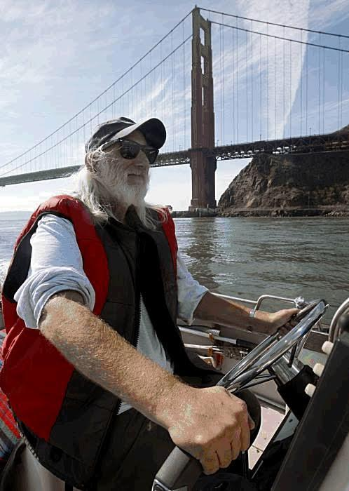 Jon Stern out on his boat underneath the Golden Gate Bridge