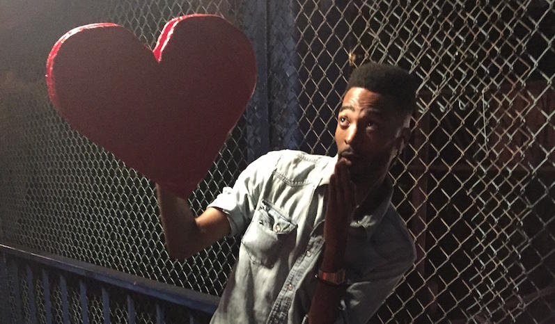 JaVonne Hatfield shows off his signature cut out heart atop his overpass dance floor