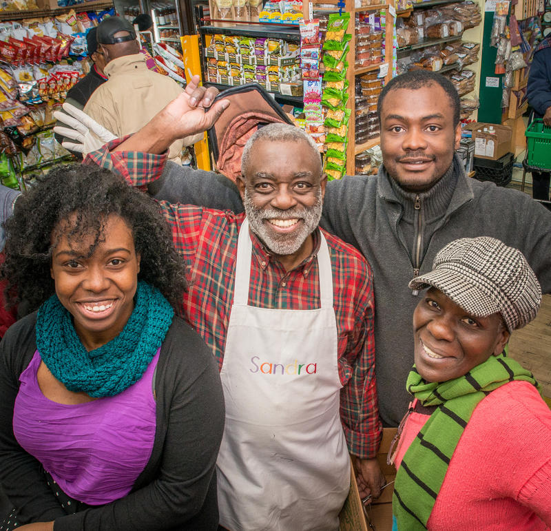 Left to right, collective member Shauntrice Martin at counter; volunteer Tony Green, Fiifi Andoh and Judy Davis, pose for a group photo at the Glut, their worker-owner cooperative store that serves Mount Rainier, Maryland, on Tuesday, March 3, 2015.
