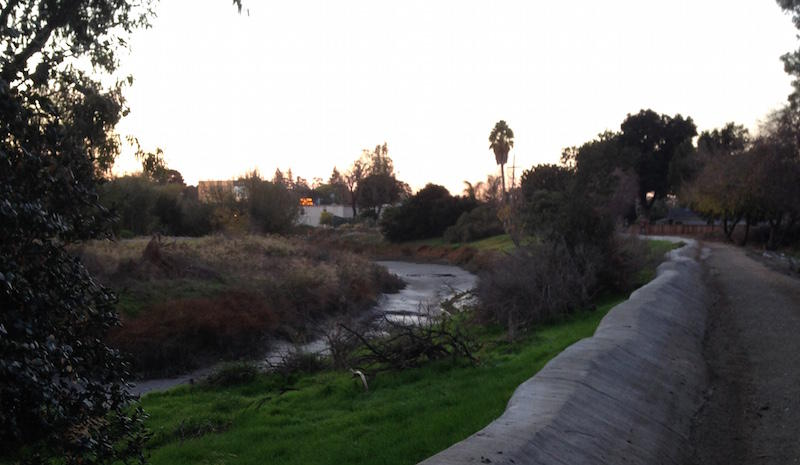 The San Francisquito Creek at low tide, without a lot of rain in it. The sandbag burrito runs along the top of the creek's levee.