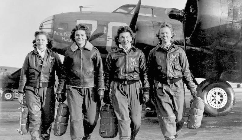 "Frances Green, Margaret (Peg) Kirchner, Ann Waldner and Blanche Osborn leaving their plane, ""Pistol Packin' Mama."""