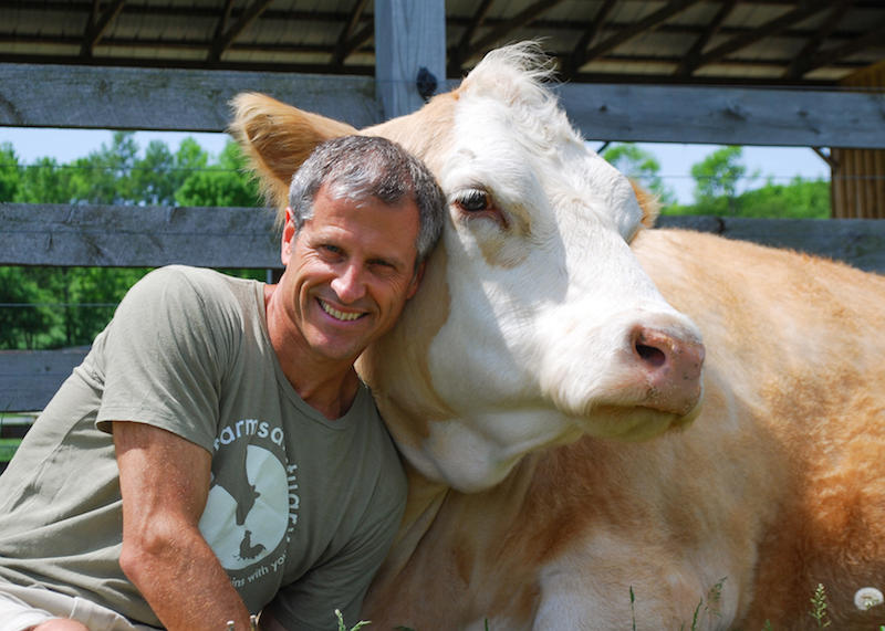 Gene Baur and Meg at Farm Sanctuary