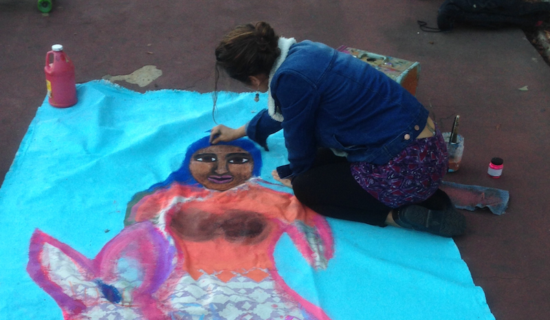 Laila Espinoza paints a mermaid in Athol Plaza Park
