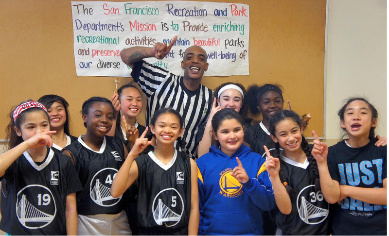 Cardell Butler poses with the SOMA Stars basketball team