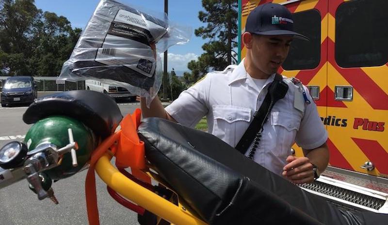 Nicolas Kinney prepares to transport a patient