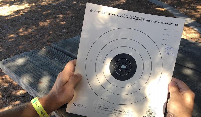 Rex Johnson shows off his paper target after attending the San Jose Pink Pistols beginner shoot.