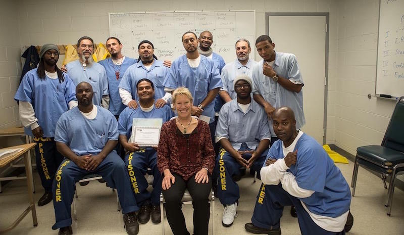 Dr. Mary Jo Bauen and new graduates of her Parenting Inside Out class at California State Prison, Solano.