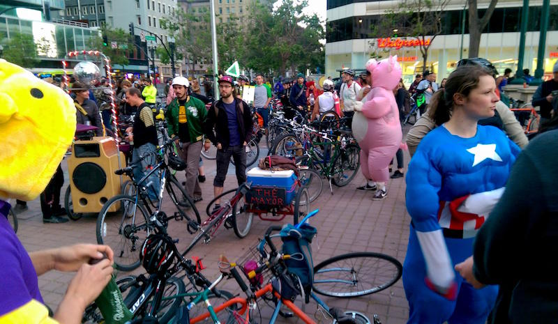 Costumed characters gather in Oakland's Frank H. Ogawa Plaza for East Bay Bike Party