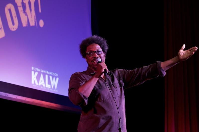 W. Kamau Bell on stage at the JCCSF