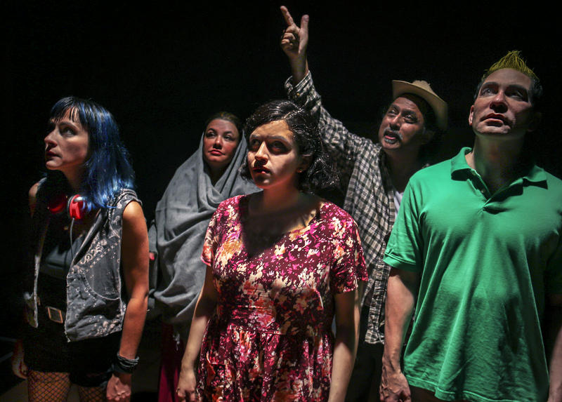 Vampi (Kitty Torres), Nayeli (Samanta Yunuen Cubias) and Tacho (Rudy Guerrero, front l to r) seek shelter for the night with (behind) Araceli (Leticia Duarte) and Porfirio (Richard Talavera) in 'Into the Beautiful North' by Karen Zacarías...