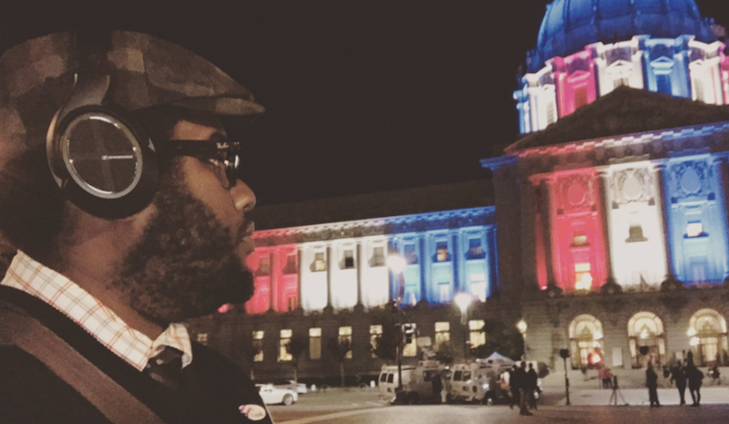Reporter J.C. stands in front of San Francisco City Hall on election night