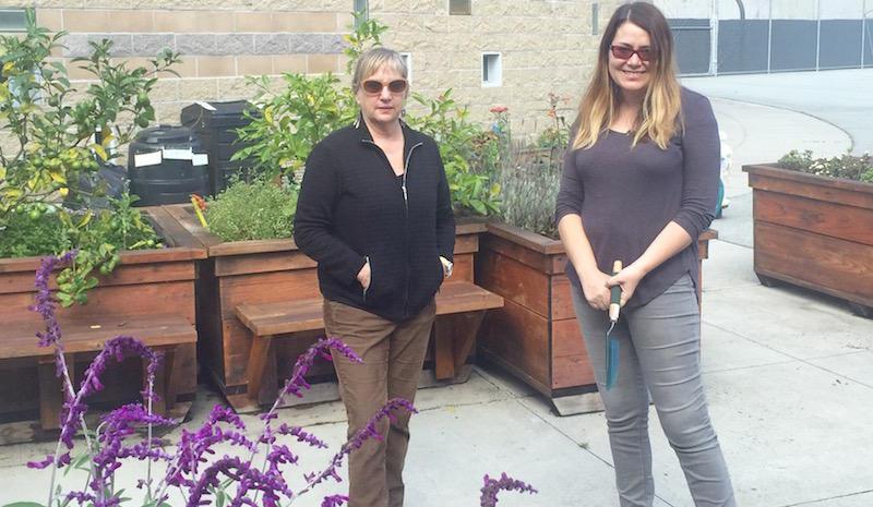 Teachers Constance Walker and Megan Mercurio outside the Woodside Learning Center garden