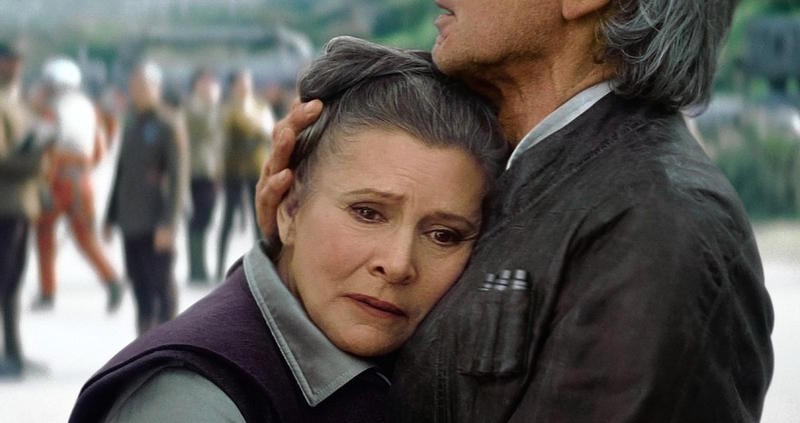 "Carrie Fisher as Leia and Harrison Ford as Han Solo in ""The Force Awakens"""
