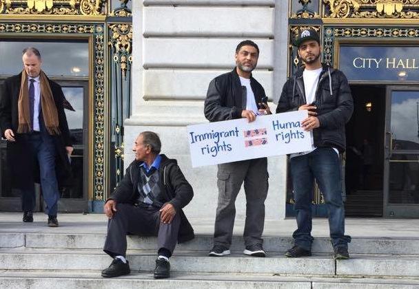 Demonstrators gather outside San Francisco City Hall
