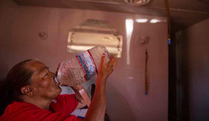 Hilda Garcia, a resident of Okieville in Tulare County, California, is one of hundreds in the county who live in households that lack running water.