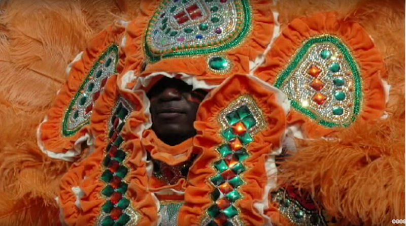 Flag Boy Twin of the Shining Star Hunters Mardi Gras Indian tribe makes a new beaded and feathered suit every year.