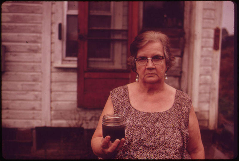 Mary Workman Holds A Jar of Undrinkable Water That Comes from Her Well, and Has Filed A Damage Suit Against the Hanna Coal Company. For the Documerica Project (1971-1977), the Environmental Protection Agency (EPA).