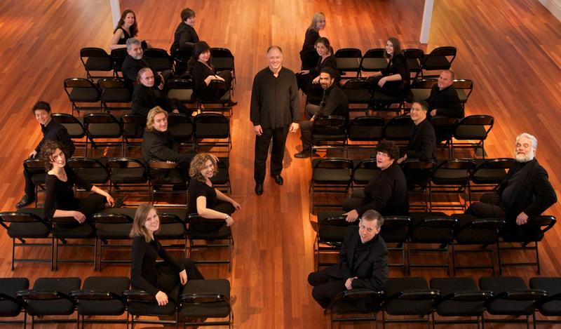 Vocal ensemble Volti with conductor Robert Geary (center)…