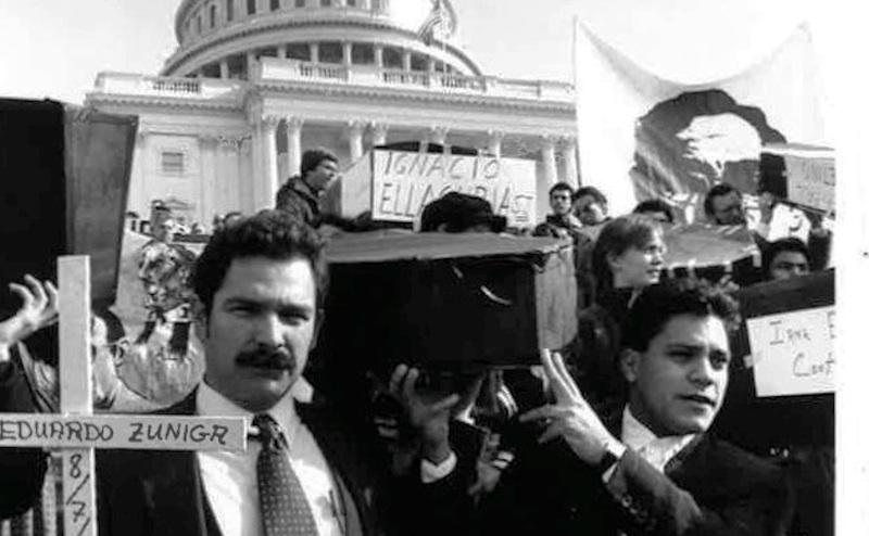 Sanctuary activist Jose Artiga (left) demonstrates in front of the U.S. Capitol in the 1980s.