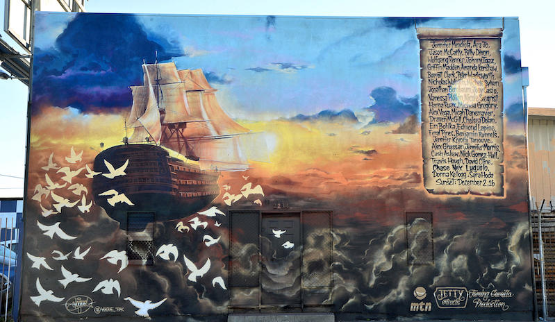 A memorial mural painted in memory of the 36 individuals who lost their lives in the Ghost Ship fire