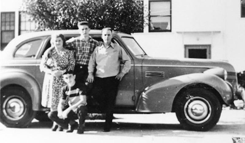 The Bronzini family: Clara, Al, Guido, in front, Lorenzo, pose with their new 1939 Pontiac.