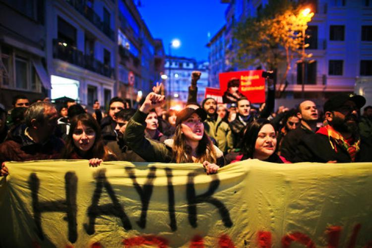 Supporters of the 'no' vote, (Hayir in Turkish) chant slogans during a protest against the referendum outcome, in Istanbul, Tuesday, April 18, 2017