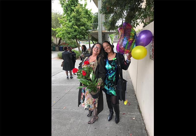Phoebe Vanderhorst and Detra Thomas of Way-Pass at Thomas' graduation from Community Mental Health