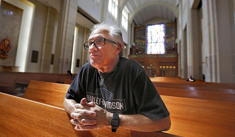 Miguel Prats reflects in the sanctuary of the Co-Cathedral of the Sacred Heart Catholic Church in downtown Houston on Good Friday, April 14, 2017. Prats, a longtime member of the Catholic church, was abused by a Catholic priest as a young man.