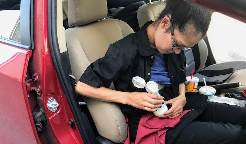 Lea Hardy pumps breast milk during a work break